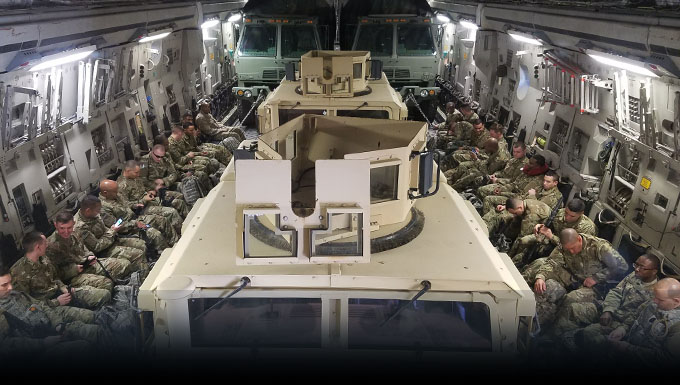 Members from the 105th Base Defense Squadron fill a C17 from Stewart and prepare for an MRX .